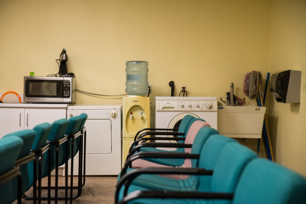 A microwave, washer, and dryer, some of the appliances MAVI teaches clients to use as part of its independent living services, line the wall of the building's meeting room.