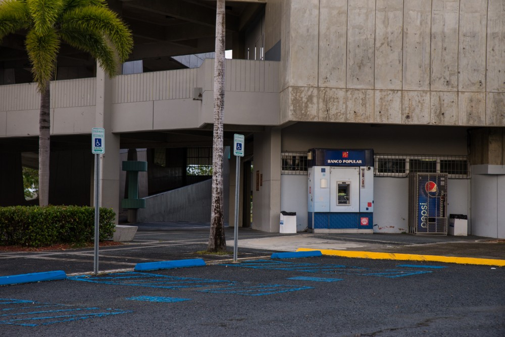 Accessible parking spots line the path leading to the Roberto Clemente Coliseum, which San Juan residents used as a shelter during Hurricane Maria. This shelter was wheelchair accessible, but most shelters were not.
