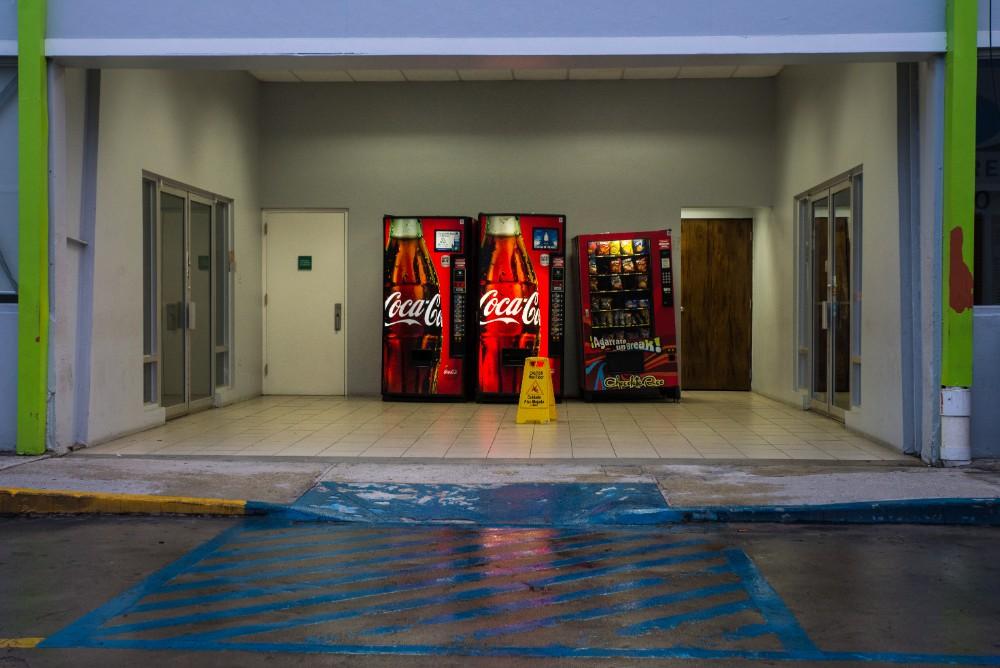 A wide curb cut leads to vending machines near the MAVI San Juan office.