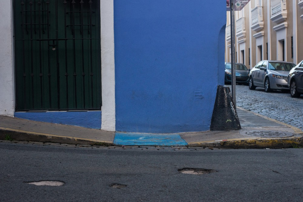 A curb cut in Old San Juan leads up to a narrow sidewalk.