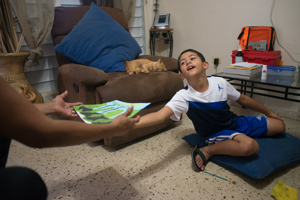 6/9/18 – Bayamón, Puerto Rico – Jayson Grau is a student in the second grade at Aurelio Perez Martinez, one of the schools set to close before the Fall. He tried another school before and had to repeat 1st grade, but has enjoyed Aurelio and thrived there, according to his mother and grandmother. The Puerto Rican Department of Education is closing 283 schools, and moving multiple schools into the same building, citing the past year's drastic drop in enrollment as one of the primary reasons to lower the amount of schools, and instead increase the amount of students in each school. Students of special education schools are one of the groups to be most negatively affected by these closings, as the new schools may not offer the resources the students need and have access to at their current schools. (Sofie Hecht Photography)