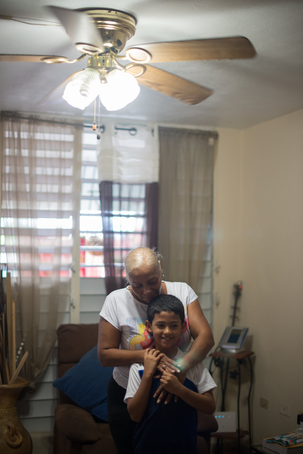 6/9/18 – Bayamón, Puerto Rico – Jayson Grau is a student in the second grade at Aurelio Perez Martinez, one of the schools set to close before the Fall. His grandmother Wanda takes the kids to school while their mother works, and lives at an apartment nearby to theirs so that she can help take care of the whole family. The Puerto Rican Department of Education is closing 283 schools, and moving multiple schools into the same building, citing the past year's drastic drop in enrollment as one of the primary reasons to lower the amount of schools, and instead increase the amount of students in each school. Students of special education schools are one of the groups to be most negatively affected by these closings, as the new schools may not offer the resources the students need and have access to at their current schools. (Sofie Hecht Photography)