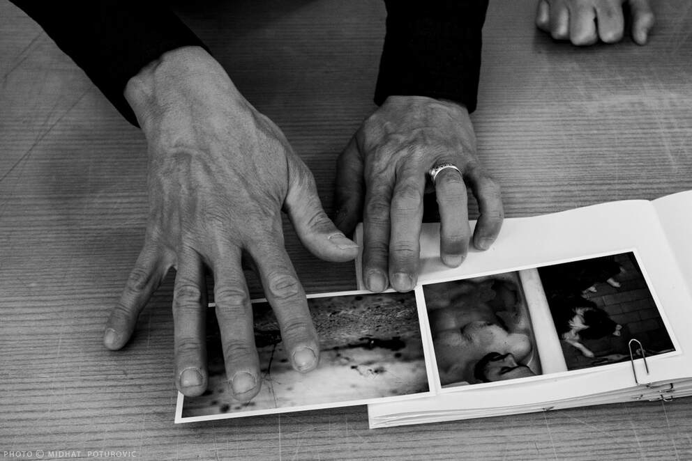 Philip Blenkinsop's hands by Midhat Poturovic